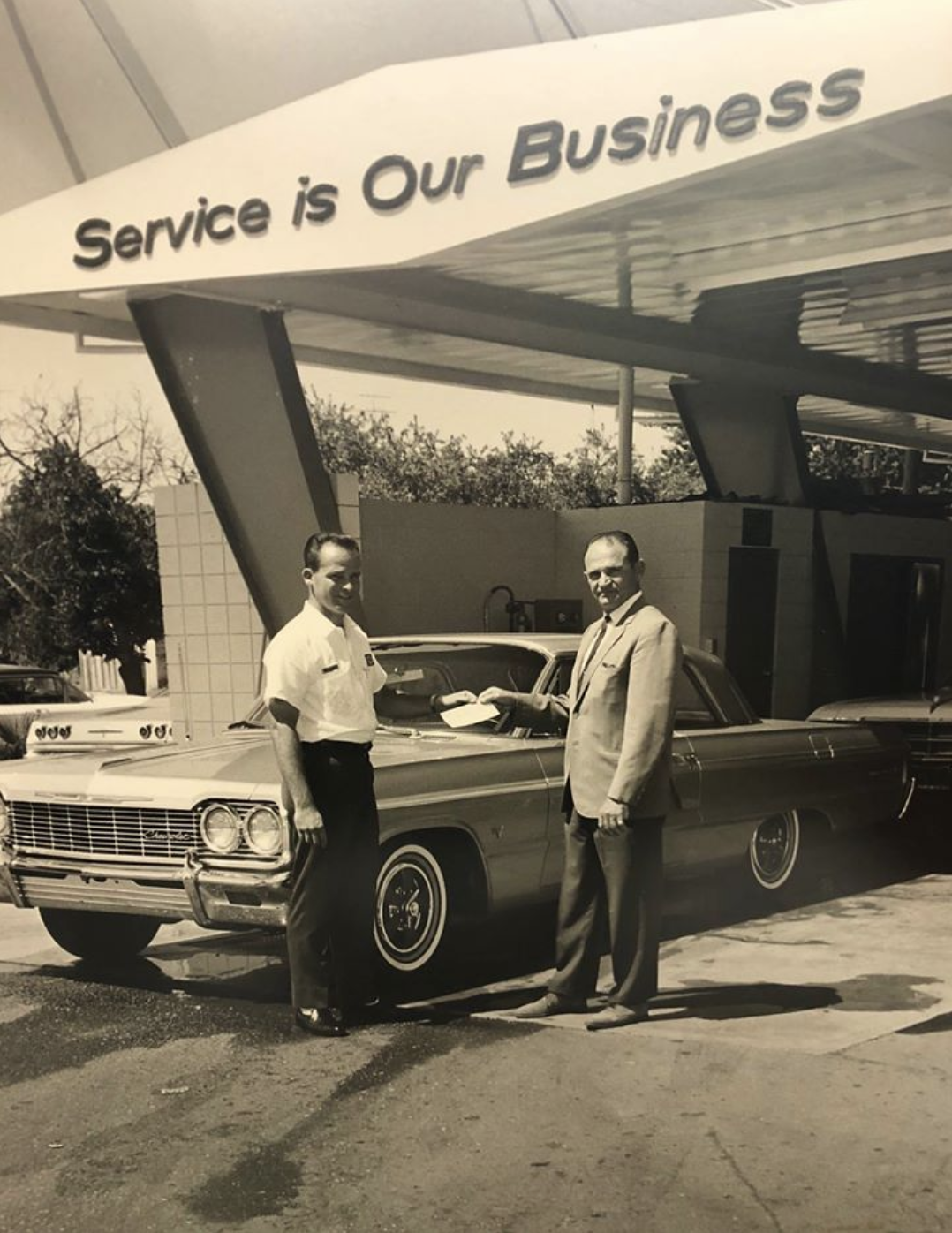 General Manager Jim Waller with a customer who just won a free car in an area raffle. 1965